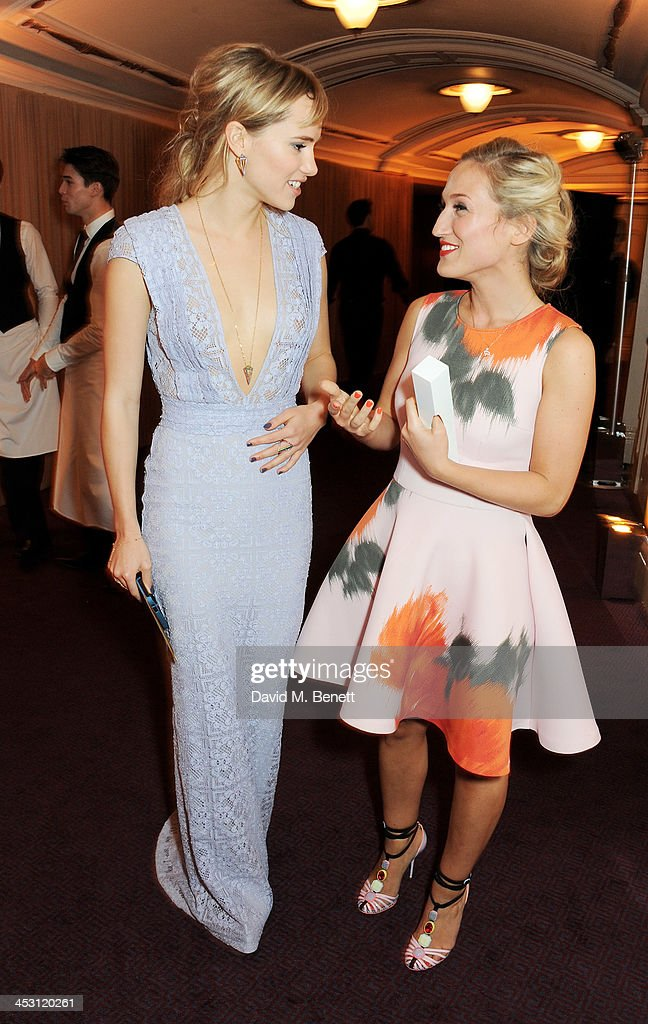 Presenter Suki Waterhouse (L) and Sophia Webster, winner of the Emerging Talent, Accessories, pose at the British Fashion Awards 2013 at London Coliseum on December 2, 2013 in London, England.