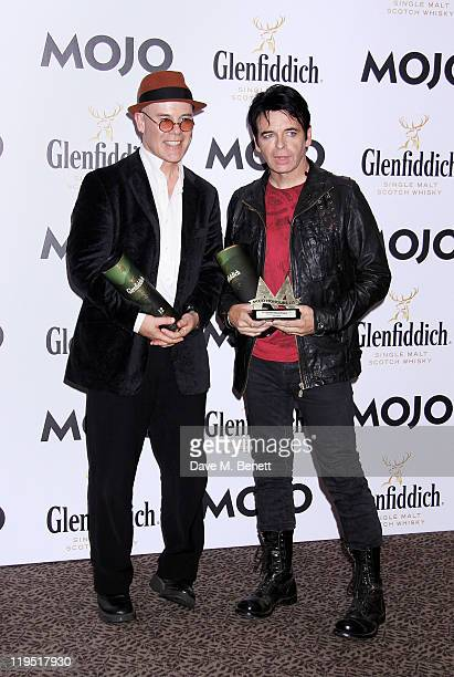 Presenter Thomas Dolby and Gary Numan pose in front of the winners boards with the MOJO Inspiration Award at the Glenfiddich Mojo Honours List 2011...
