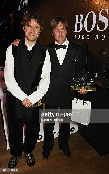 Presenter Thomas Heatherwick and Marc Newson winner of GQ Creative Icon of the Year attend the GQ Men Of The Year Awards at The Royal Opera House on...
