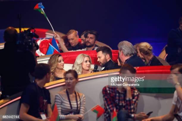 Presenter Timur Miroshnychenko interviews Amy Shelley and Lisa Vol of the band OG3NE during the rehearsal for ''The final of this year's Eurovision...