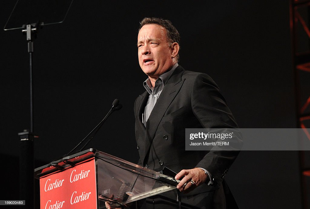 Presenter <a gi-track='captionPersonalityLinkClicked' href=/galleries/search?phrase=Tom+Hanks&family=editorial&specificpeople=201790 ng-click='$event.stopPropagation()'>Tom Hanks</a> speaks onstage during the 24th annual Palm Springs International Film Festival Awards Gala at the Palm Springs Convention Center on January 5, 2013 in Palm Springs, California.