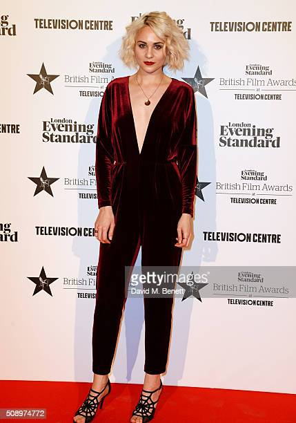 Presenter Tuppence Middleton poses in front of the Winners Boards at the London Evening Standard British Film Awards at Television Centre on February...