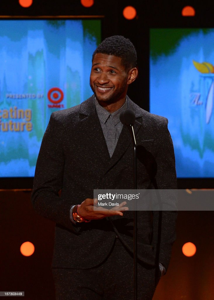 Presenter Usher speaks onstage during UNCF's 33rd annual An Evening Of Stars held at Pasadena Civic Auditorium on December 1, 2012 in Pasadena, California.