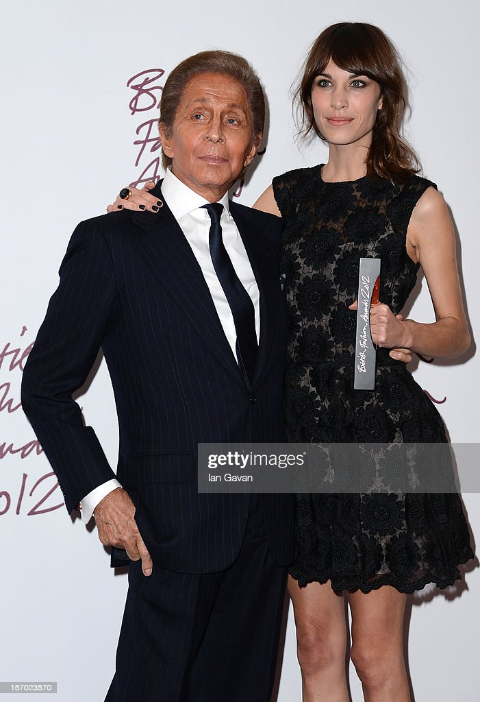 Presenter Valentino Garavani and Alexa Chung, winner of the British Style award supported by Vodafone, poses in the awards room at the British Fashion Awards 2012 at The Savoy Hotel on November 27, 2012 in London, England.