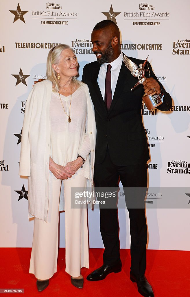 Presenter Vanessa Redgrave and Idris Elba winner of the Best Actor award for 'Beasts Of No Nation' pose in front of the Winners Boards at the London...