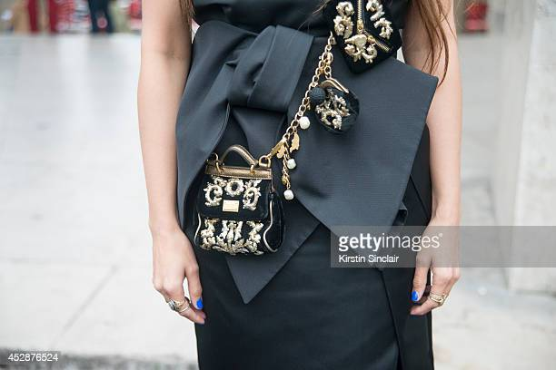 Presenter Zara Martin wearing a Dolce and Gabbana bag and Dice Kayak dress day 5 of Paris Haute Couture Fashion Week Autumn/Winter 2014 on July 10...