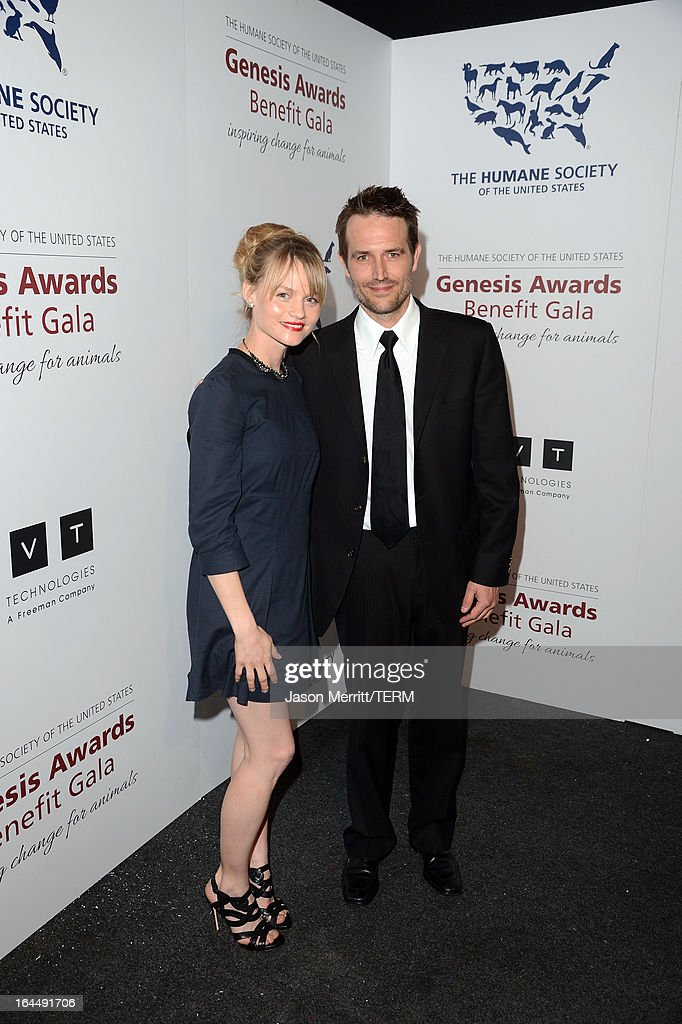 Presenters actors Lindsay Pulsipher and Michael Vartan pose backstage at The Humane Society of the United States 2013 Genesis Awards Benefit Gala at The Beverly Hilton Hotel on March 23, 2013 in Los Angeles, California.