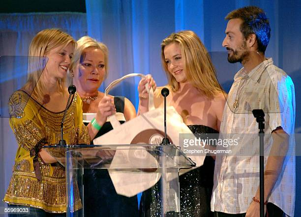 Presenters actress Amy Smart her mom Judy actress Alicia Silverstone and her brother present the award for Best Reality Television show onstage...