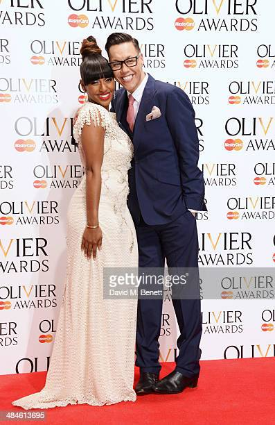 Presenters Alexandra Burke and Gok Wan pose in the press room at the Laurence Olivier Awards at The Royal Opera House on April 13 2014 in London...