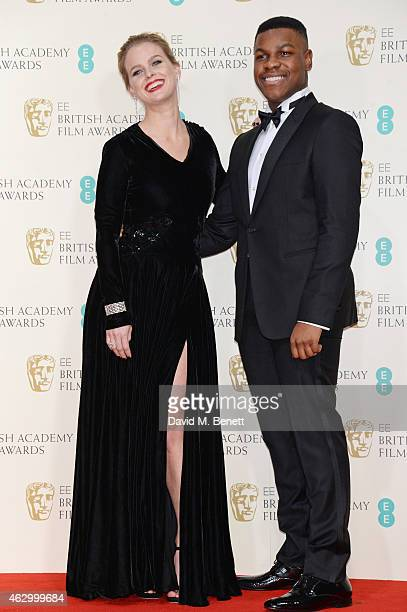 Presenters Alice Eve and John Boyega pose in the winners room at the EE British Academy Film Awards at The Royal Opera House on February 8 2015 in...