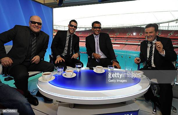 Presenters Andy Gray Jamie Redknapp Ruud Gullit and Richard Keys pose for the camera wearing 3D glasses before the world's first live 3D TV football...