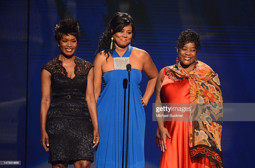 Presenters <a gi-track='captionPersonalityLinkClicked' href=/galleries/search?phrase=Angela+Bassett&family=editorial&specificpeople=171174 ng-click='$event.stopPropagation()'>Angela Bassett</a>; <a gi-track='captionPersonalityLinkClicked' href=/galleries/search?phrase=Lela+Rochon&family=editorial&specificpeople=1198825 ng-click='$event.stopPropagation()'>Lela Rochon</a> and <a gi-track='captionPersonalityLinkClicked' href=/galleries/search?phrase=Loretta+Devine&family=editorial&specificpeople=214600 ng-click='$event.stopPropagation()'>Loretta Devine</a> speak onstage during the 2012 BET Awards at The Shrine Auditorium on July 1, 2012 in Los Angeles, California.
