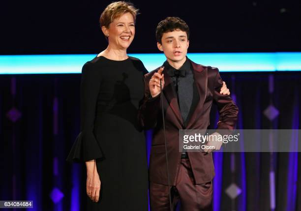Presenters Annette Bening and Lucas Jade Zumann speak onstage at the 16th Annual AARP The Magazine's Movies For Grownups Awards at the Beverly...