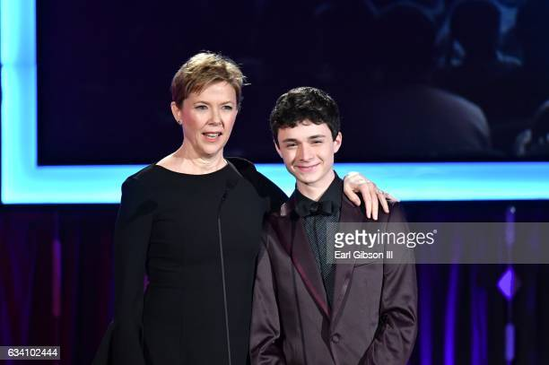 Presenters Annette Benning and Lucas Jade Zumann speak onstage at AARP's 16th Annual Movies For Grownups Awards at the Beverly Wilshire Four Seasons...