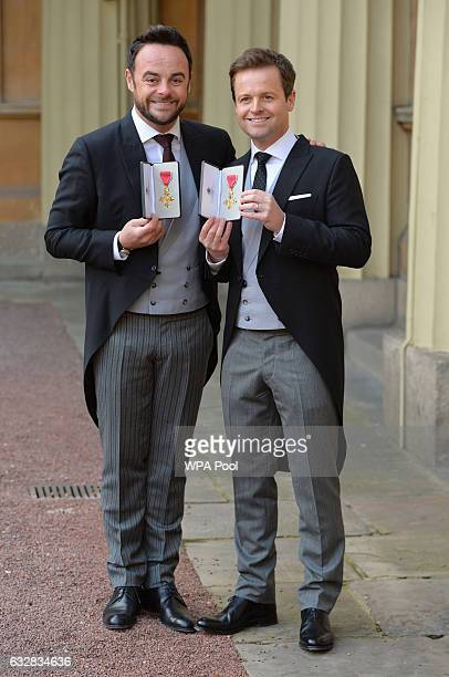 TV presenters Ant and Dec pose with theirs OBEs received by the Prince of Wales during an Investiture ceremony at Buckingham Palace on January 27...