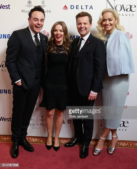 Presenters Anthony McPartlin and Declan Donnelly pose with Rita Ora and Geri Horner during the Prince's Trust Celebrate Success Awards at the London...
