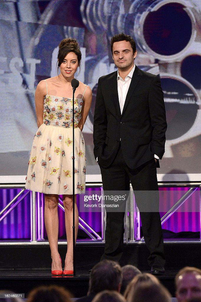 Presenters <a gi-track='captionPersonalityLinkClicked' href=/galleries/search?phrase=Aubrey+Plaza&family=editorial&specificpeople=5299268 ng-click='$event.stopPropagation()'>Aubrey Plaza</a> and Jake Johnson speak onstage during the 2013 Film Independent Spirit Awards at Santa Monica Beach on February 23, 2013 in Santa Monica, California.