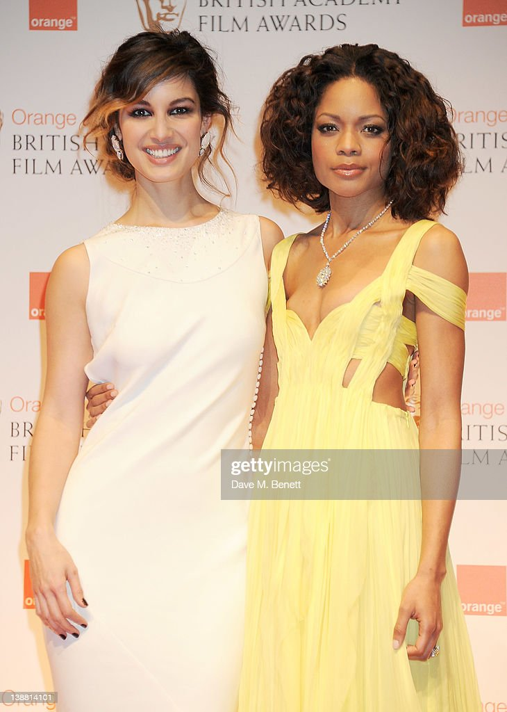 Presenters Berenice Marlohe and Naomie Harris pose in the press room at the Orange British Academy Film Awards 2012 at The Royal Opera House on...