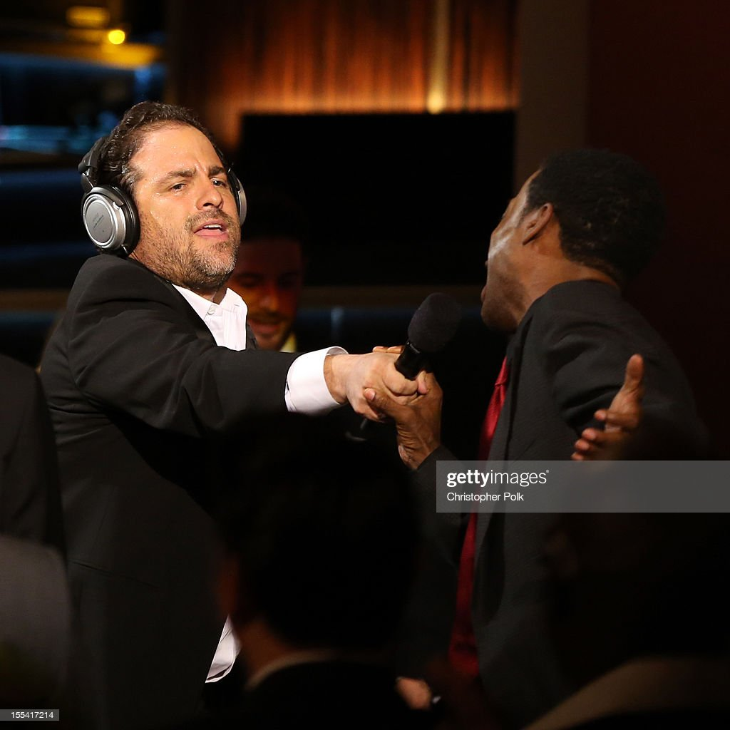 Presenters Brett Ratner and Chris Rock perform in the audience at Spike TV's 'Eddie Murphy: One Night Only' at the Saban Theatre on November 3, 2012 in Beverly Hills, California.