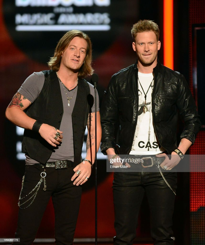 Presenters Brian Kelley (R) and <a gi-track='captionPersonalityLinkClicked' href=/galleries/search?phrase=Tyler+Hubbard&family=editorial&specificpeople=9453787 ng-click='$event.stopPropagation()'>Tyler Hubbard</a> of Florida Georgia Line speak onstage during the 2013 Billboard Music Awards at the MGM Grand Garden Arena on May 19, 2013 in Las Vegas, Nevada.