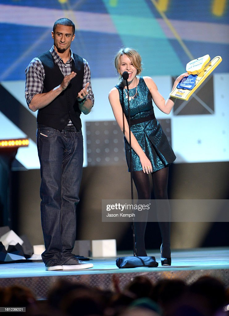 Presenters Colin Kaepernick and Bridgit Mendler speak onstage at the Third Annual Hall of Game Awards hosted by Cartoon Network at Barker Hangar on February 9, 2013 in Santa Monica, California. 23270_003_JK_0046.JPG