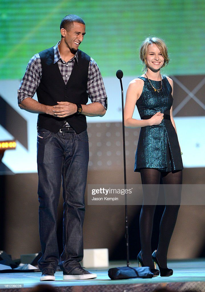 Presenters Colin Kaepernick and Bridgit Mendler speak onstage at the Third Annual Hall of Game Awards hosted by Cartoon Network at Barker Hangar on February 9, 2013 in Santa Monica, California. 23270_003_JK_0031.JPG