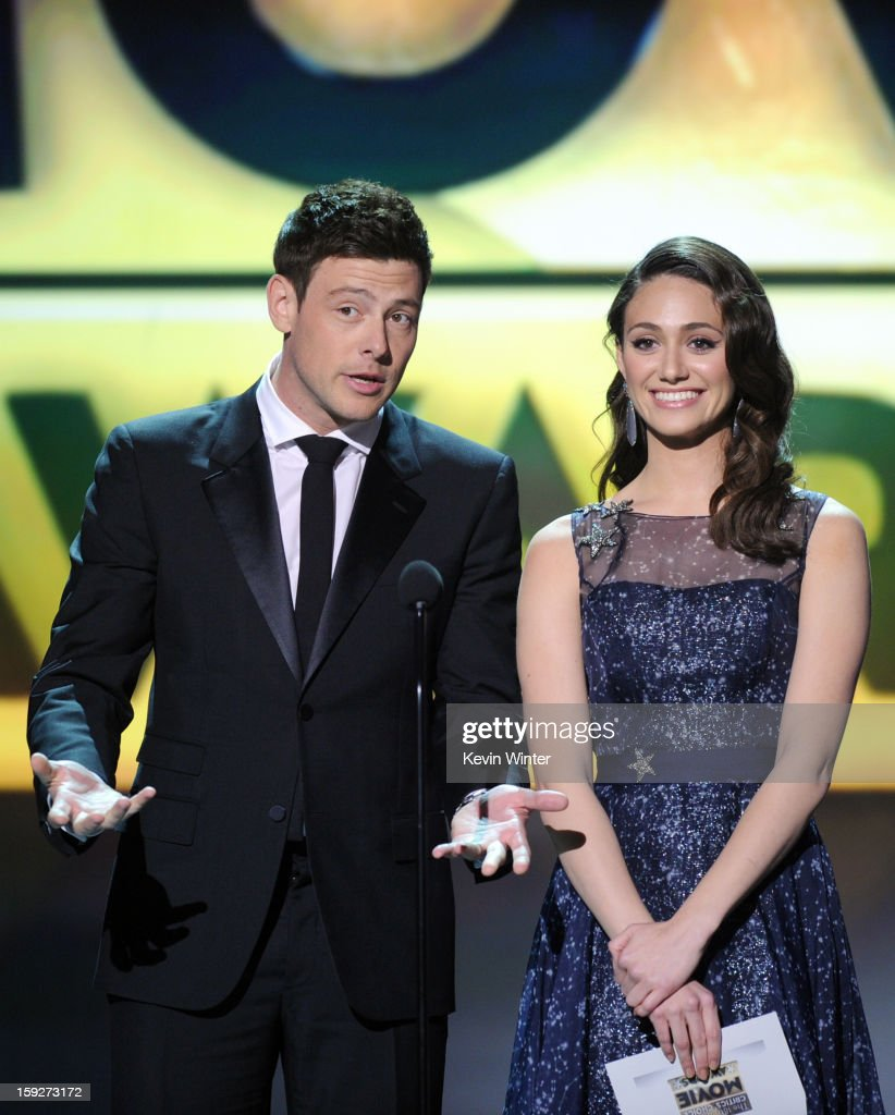 Presenters Cory Monteith (L) and Emmy Rossum speak onstage at the 18th Annual Critics' Choice Movie Awards held at Barker Hangar on January 10, 2013 in Santa Monica, California.