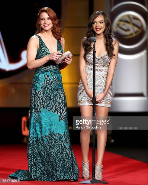 Presenters Courtney Hope and Reign Edwards attend the 44th annual daytime creative arts Emmy awards show at Pasadena Civic Auditorium on April 28...