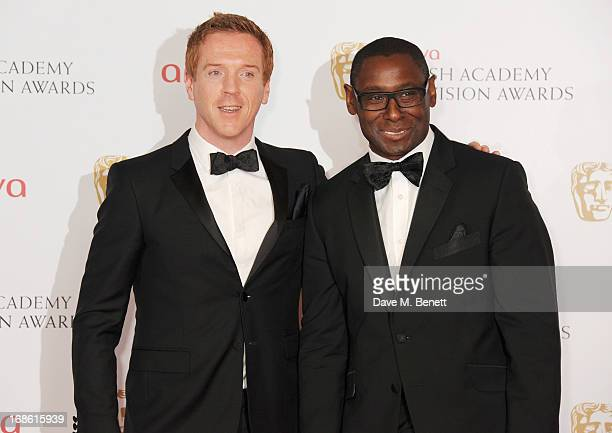 Presenters Damian Lewis and David Harewood pose in the press room at the Arqiva British Academy Television Awards 2013 at the Royal Festival Hall on...