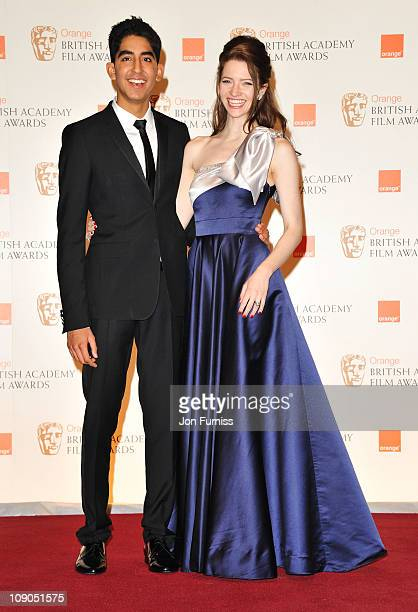 Presenters Dev Patel and Talulah Riley pose in the press room during the 2011 Orange British Academy Film Awards at The Royal Opera House on February...