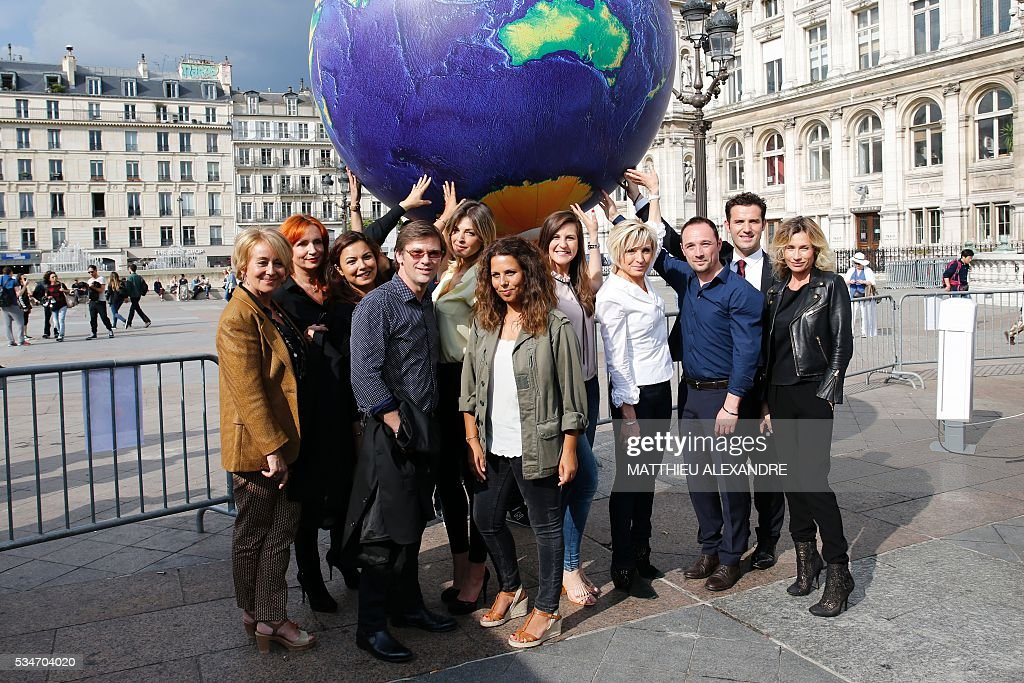 TV presenters Dominique Schibli, Celine Da Costa, Anais Baydemir, Laurent Romejko, Eleonore Boccara, Myriam Seurat, Marlene Duret, Evelyne Dheliat, Loic Rousval, Marc Hay and Sandra Larue pose during the 13th International Meteo and Climate Forum on May 27, 2016 in Paris. / AFP / MATTHIEU