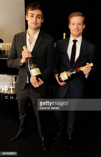 Presenters Douglas Booth and Sam Reid pose backstage at the Moet British Independent Film Awards 2013 at Old Billingsgate Market on December 8 2013...