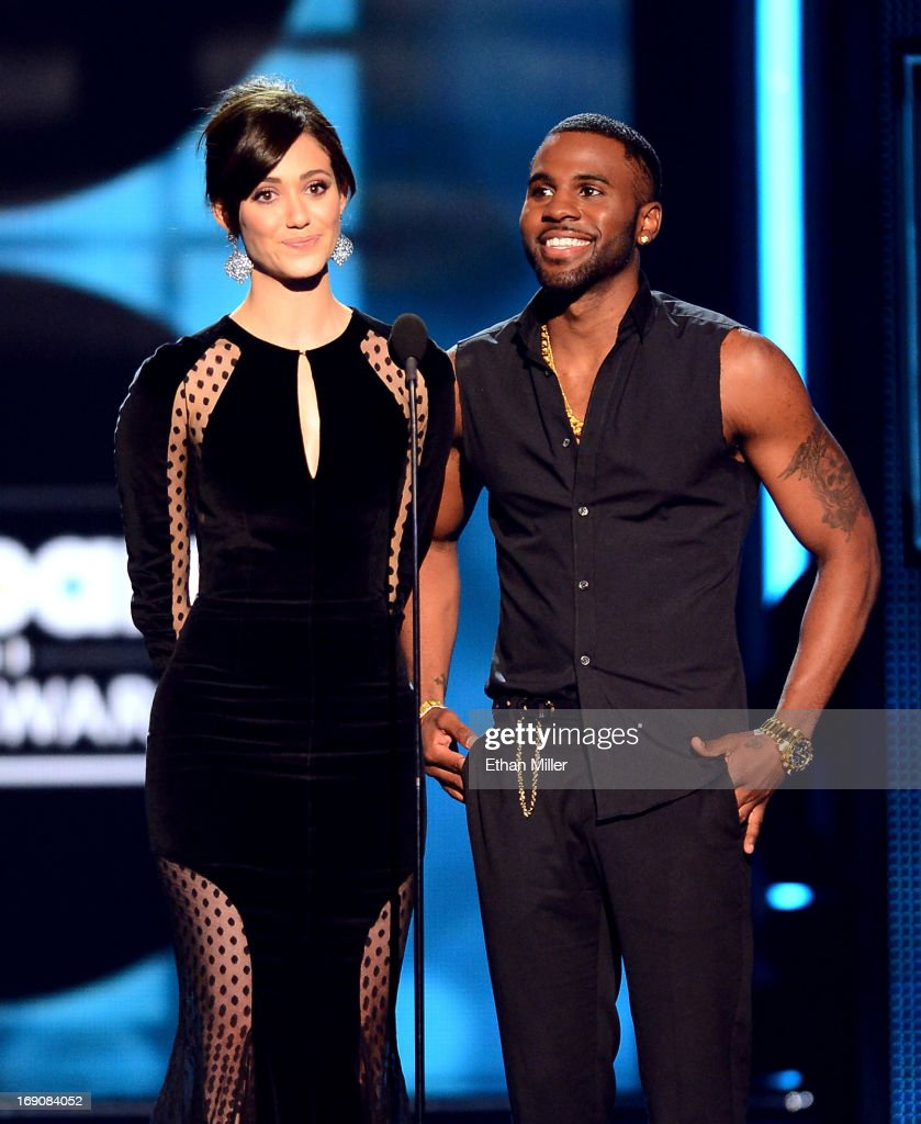 Presenters Emmy Rossum and Jason Derulo speak onstage during the 2013 Billboard Music Awards at the MGM Grand Garden Arena on May 19, 2013 in Las Vegas, Nevada.