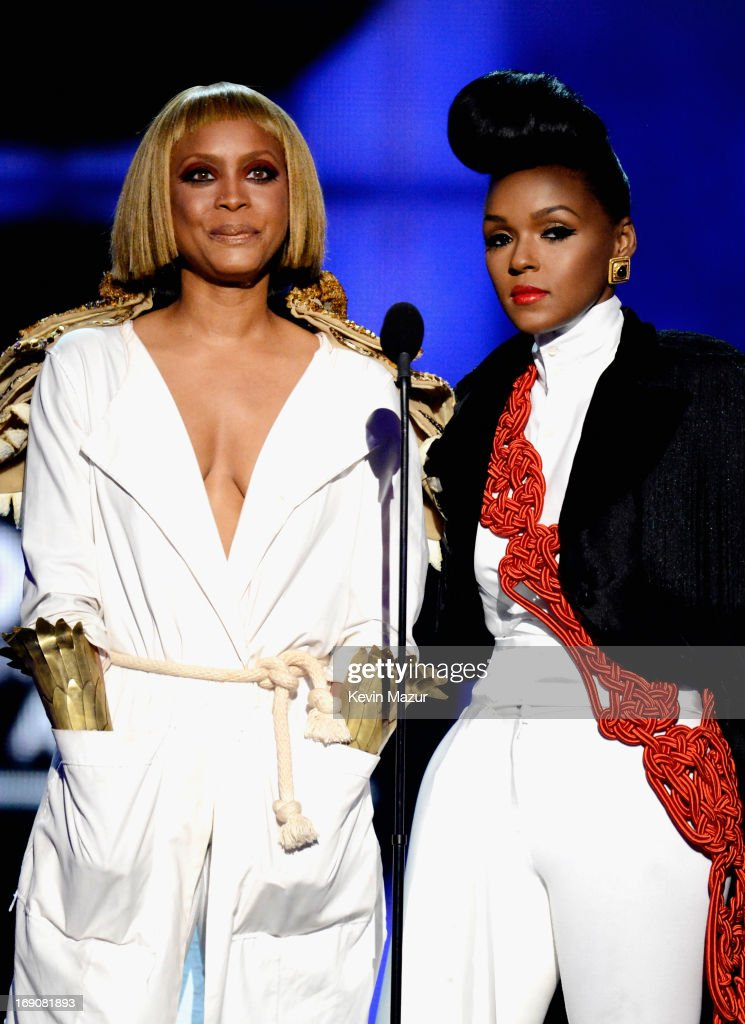 Presenters <a gi-track='captionPersonalityLinkClicked' href=/galleries/search?phrase=Erykah+Badu&family=editorial&specificpeople=224744 ng-click='$event.stopPropagation()'>Erykah Badu</a> and <a gi-track='captionPersonalityLinkClicked' href=/galleries/search?phrase=Janelle+Monae&family=editorial&specificpeople=715847 ng-click='$event.stopPropagation()'>Janelle Monae</a> speak onstage during the 2013 Billboard Music Awards at the MGM Grand Garden Arena on May 19, 2013 in Las Vegas, Nevada.