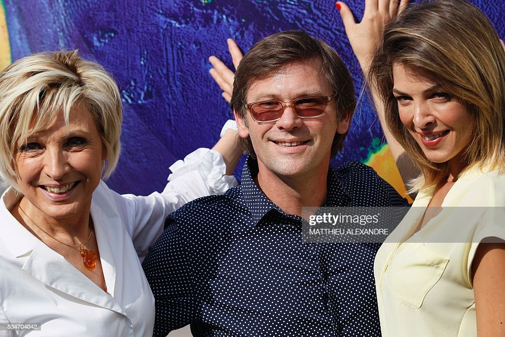 TV presenters Evelyne Dheliat, Laurent Romejko and Eleonore Boccara, pose during the 13th International Meteo and Climate Forum on May 27, 2016 in Paris. / AFP / MATTHIEU