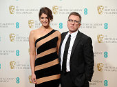 Presenters Gemma Arterton and Tim Roth pose in the press room at the EE British Academy Film Awards at The Royal Opera House on February 10 2013 in...