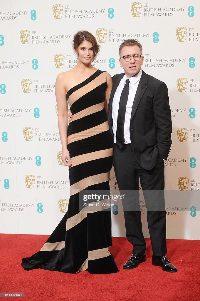 Presenters Gemma Arterton (L) and Tim Roth pose in the press room at the EE British Academy Film Awards at The Royal Opera House on February 10, 2013 in London, England.