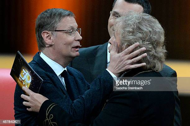 Presenters Guenther Jauch and Thomas Gottschalk try to kiss each other during the taping of the anniversary show '30 Jahre RTL Die grosse...