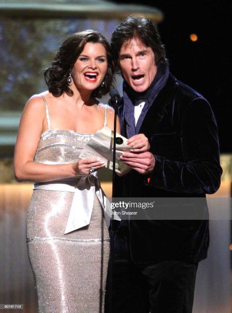 Presenters Heather Tom (L) and Ronn Moss speak during the 36th Annual Daytime Emmy Awards at The Orpheum Theatre on August 30, 2009 in Los Angeles, California.