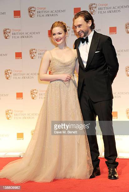 Presenters Holliday Grainger and Joseph Mawle pose in the press room at the Orange British Academy Film Awards 2012 at The Royal Opera House on...