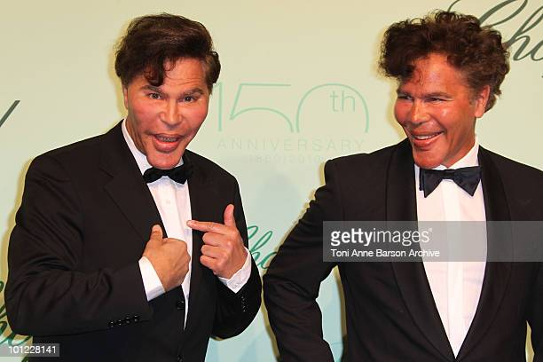 Presenters Igor and Grichka Bogdanoff attend the Chopard 150th Anniversary Party at the VIP Room Palm Beach during the 63rd Annual International...