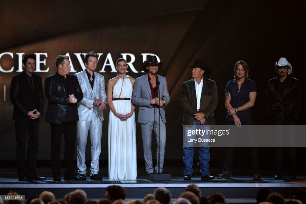Presenters Jay DeMarcus, Joe Don Rooney and Gary LeVox of Rascall Flatts, Faith Hill, Tim McGraw, George Strait, Keith Urban and Brad Paisley present the Pinnicle Award during the 47th annual CMA Awards at the Bridgestone Arena on November 6, 2013 in Nashville, Tennessee.