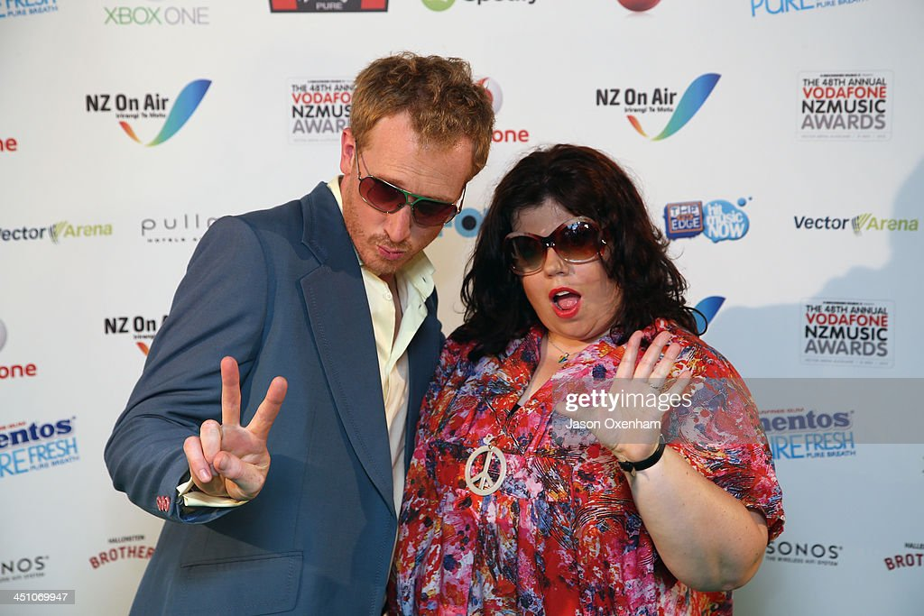Presenters Jesse Griffin (L) and Urzila Carlson pose during the New Zealand Music Awards at the Vector Arena on November 21, 2013 in Auckland, New Zealand.