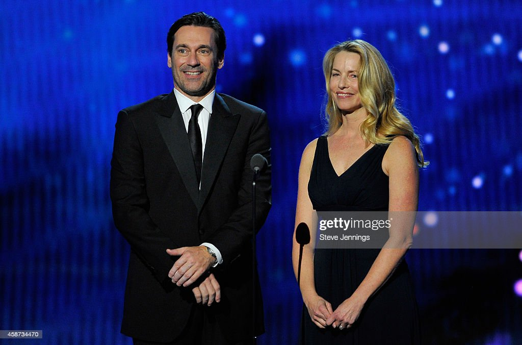 Presenters Jon Hamm and Laurene Powell Jobs (R) speak onstage during the Breakthrough Prize Awards Ceremony Hosted By Seth MacFarlane at NASA Ames Research Center on November 9, 2014 in Mountain View, California.