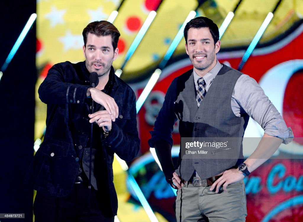 Presenters Jonathan Scott and Drew Scott speak onstage during the American Country Awards 2013 at the Mandalay Bay Events Center on December 10 2013...