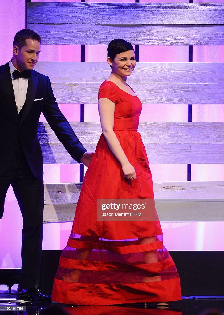 Presenters Josh Dallas (L) and Ginnifer Goodwin onstage during the 15th Annual Costume Designers Guild Awards with presenting sponsor Lacoste at The Beverly Hilton Hotel on February 19, 2013 in Beverly Hills, California.