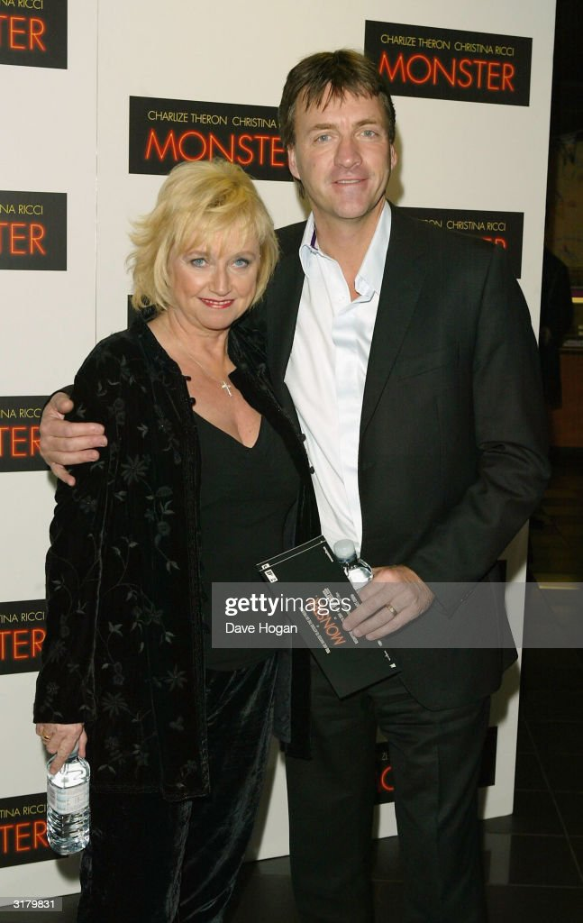 Presenters <a gi-track='captionPersonalityLinkClicked' href=/galleries/search?phrase=Judy+Finnigan&family=editorial&specificpeople=228499 ng-click='$event.stopPropagation()'>Judy Finnigan</a> and Richard Madeley arrive at the UK premiere of 'Monster' at Vue West End on March 31, 2004 in London, England.