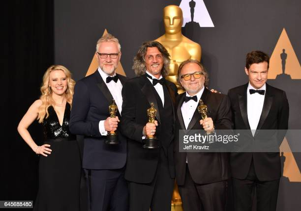 Presenters Kate McKinnon and Jason Bateman pose with makeup artists Giorgio Gregorini Alessandro Bertolazzi and Christopher Allen Nelson winners of...
