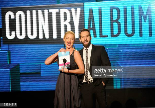 Presenters Katherine Heigl and Josh Kelley speak onstage at the 2011 American Music Awards held at Nokia Theatre LA LIVE on November 20 2011 in Los...