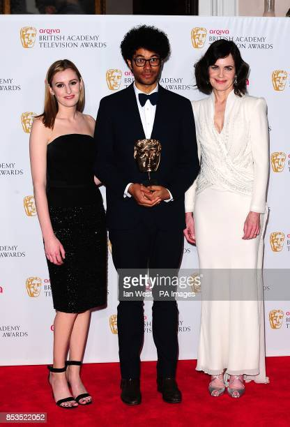 Presenters Laura Carmichael and Elizabeth McGovern with winner of Male Performance in a Comedy Programme Richard Ayoade at the Arqiva British Academy...